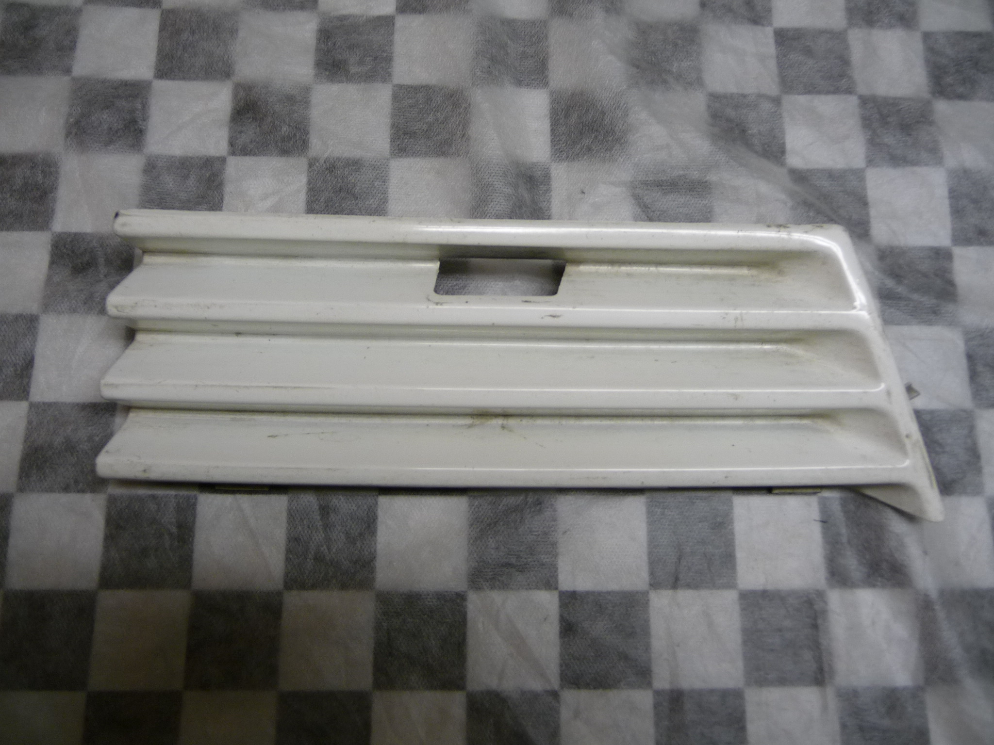 1996 Mercedes Benz W210 E320 Lower Right Hand White Grille, Tow Hook Cover A2108800005 OEM OE