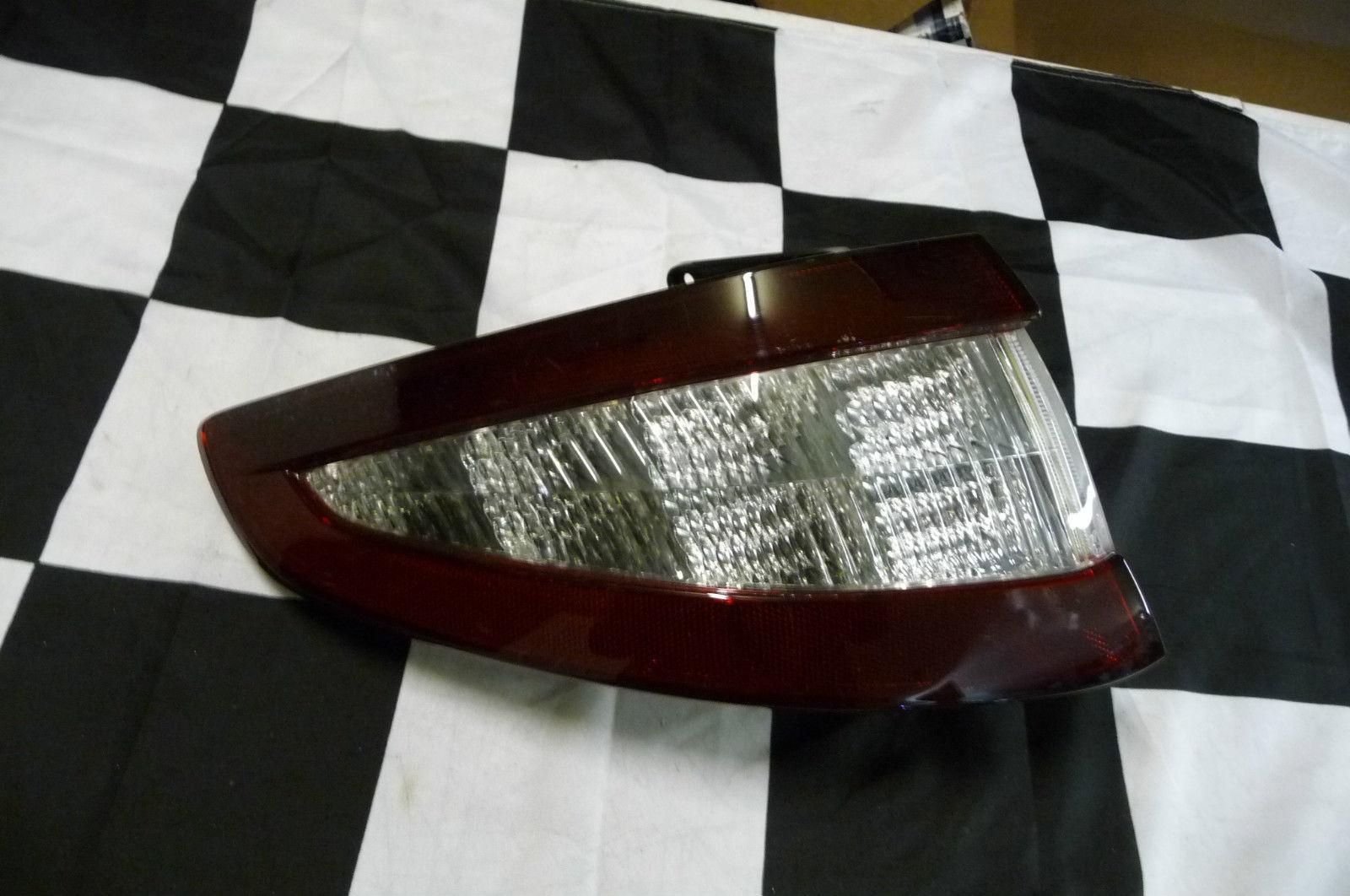 Maserati GranTurismo Driver side Left Tail Light  Tinted 234379 - Used Auto Parts Store | LA Global Parts